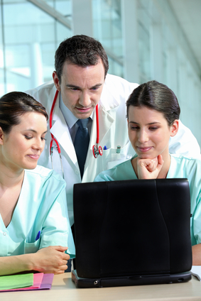 A team of medical professionals consulting patient records